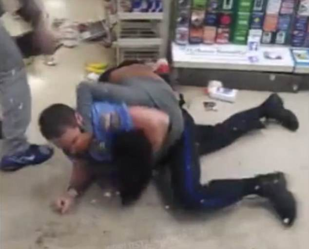The officer slams the woman to the ground but she fights back hard
